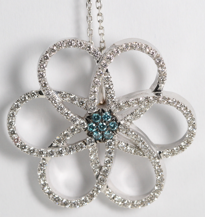 Diamond Flower Pendant in 18k White Gold Setting with 115 Blue & White Diamond Equaling 0.98 carats
