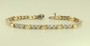 A 14k White and Yellow Gold link diamond bracelet with millennial and round cut diamonds