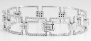 An 18 karat white gold invisible set diamond bracelet