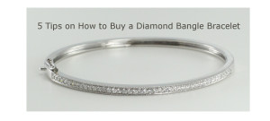 A diamond bangle bracelet with an 18 karat white gold setting