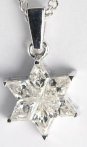 A diamond pendant in the shape of a Star of David, set in 18 karat white gold with a chain