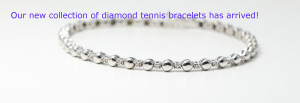 An 18k White Gold plain gold diamond tennis bracelet