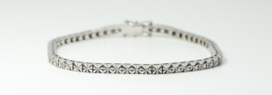 A 14k White Gold Round Diamond Tennis Bracelet with Pave Setting
