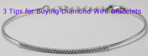 A 14 karat white gold round diamond wire bracelet